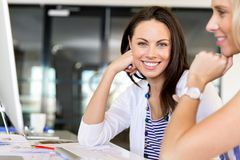 Happy entrepreneur or freelancer in an office or home Stock Images