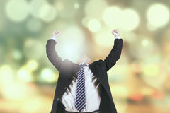 Happy entrepreneur with light glitter background Stock Image
