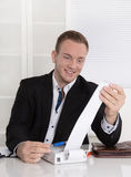 Happy entrepreneur looking at paper roll: concept for increasing Royalty Free Stock Photo