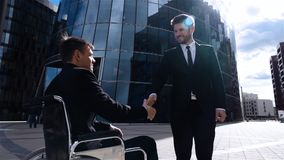 Happy Entrepreneur Shaking Hands With Disabled Businessman Outdoor stock video footage