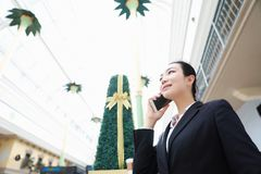 Asian black Business Woman on Cell Phone Royalty Free Stock Photo