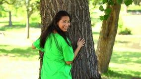 Happy environmental activist hugging a tree stock video