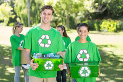 Happy environmental activists in the park with recyclables Stock Photo