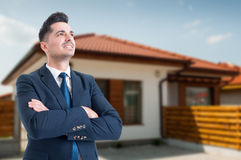 Happy estate agent with folded arms. Standing outside and looking confident with copy text space Stock Image