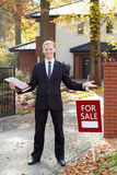Happy estate agent during his work. Outside the house Royalty Free Stock Images