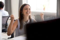 Happy euphoric millennial girl winner excited by good news. Positive test exam result, got job promotion, young women student celebrating success motivated by stock image