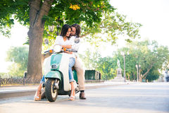 Happy european couple flirting on scooter Royalty Free Stock Photos