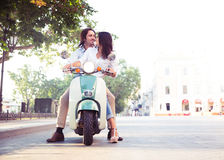 Happy european couple flirting on scooter Royalty Free Stock Image
