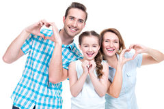 Happy european family with child shows the heart shape Royalty Free Stock Photo