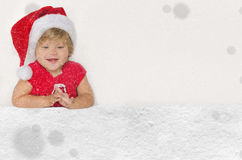 Happy european girl in Santa suit with snow Stock Photography