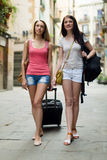 Happy european girls traveling and smiling on vacation Stock Photos