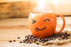 Happy every morning with drink coffee. Smiley coffee mug on wood background, happy every morning with drink coffee concept Stock Images