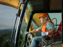 Happy excavator driver Stock Image