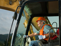 Happy excavator driver Stock Photo