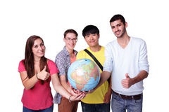 Happy exchange student. Smile group of happy exchange students with a terrestrial globe isolated on white background, caucasian and asian Royalty Free Stock Images