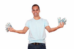 Happy and excited adult man with cash money Stock Image