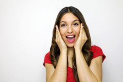 Happy excited amazed young woman looking to the camera over white background.  Royalty Free Stock Photography