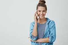 Happy excited attractive young woman calling friend spending free-time home gossiping discussing last fashion trends stock photo
