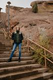 Young Beautiful Modern Caucasian Woman Smiling While Traveling to Red Rocks Park in United States Outside in Nature at Park royalty free stock image
