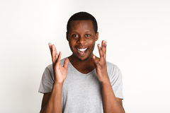 Happy excited black man, facial expression, human emotions. Happy enthusiastic black man laughing, human emotions, white background, studio shot Stock Photos