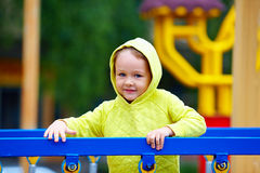 Happy excited boy having fun on attraction playground Royalty Free Stock Images