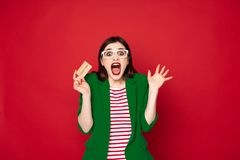 Happy excited brunette lady with credit card stock images
