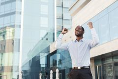 Happy excited businessman celebrate. Winner, black man outdoors stock images