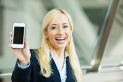 Happy excited businesswoman showing her smart phone Stock Images