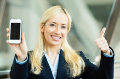 Happy excited businesswoman showing her smart phone Royalty Free Stock Photo