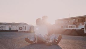 Hipster couple at sunset on rooftop
