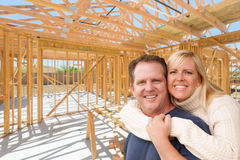 Happy Excited Couple On Site Inside Their New Home Construction Stock Photography