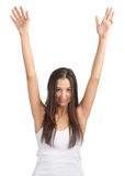 Happy excited girl with arms extended. Portrait of pretty young woman with arms extended. Over white background Royalty Free Stock Photos