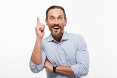 Happy excited handsome mature businessman. Picture of happy excited handsome mature businessman standing isolated over white background. Looking camera have an Royalty Free Stock Photos