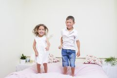 Happy and Excited Kids Playing Indoors. Royalty Free Stock Photo