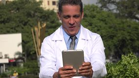 Happy excited male doctor or lab technician. A handsome adult hispanic man stock footage