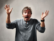 Happy excited man. Glad excited laughing mature man expressions over gray background Royalty Free Stock Image