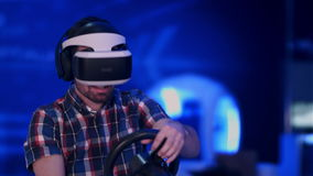Happy and excited man playing racing video game with virtual reality headset. Professional shot in 4K resolution. 079. You can use it e.g. in your commercial stock video footage
