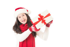 Happy excited santa woman showing christmas prensent Stock Photo