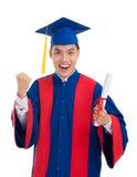 Happy excited school-leaver. Portrait of happy excited school-leaver with a diploma in his hand stock image