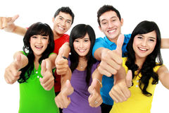 Happy excited smiling friends. Showing thumb up gesture Stock Photography