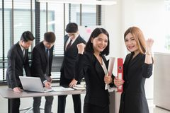 Happy excited successful businesswoman triumphing in office. Royalty Free Stock Photography