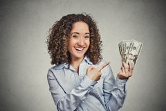 Happy excited successful young business woman holding money dollar bills Royalty Free Stock Images