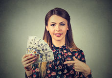 Happy excited successful young business woman holding money dollar bills in hand Stock Photo
