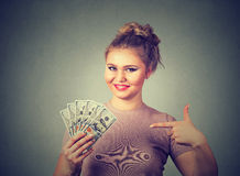 Happy excited successful young business woman holding money dollar bills in hand Stock Photos