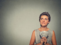 Happy excited successful young woman holding money dollar bills Royalty Free Stock Images