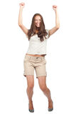 Happy excited woman. Full length portrait of happy excited woman celebrating her success. Over white background Stock Photos