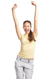 Happy excited woman with arms extended. Full length portrait of happy excited girl with arms extended. Over white background Stock Photo