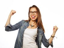 Happy excited woman celebrating her success. Royalty Free Stock Image