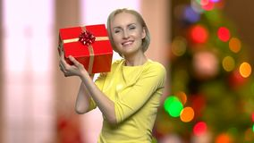 Happy excited woman with Christmas gift box. stock video footage