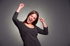 Happy excited woman dancing Royalty Free Stock Images